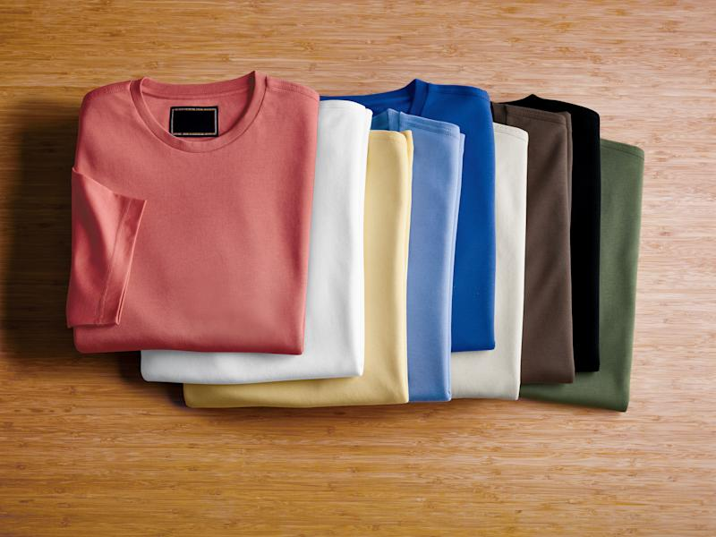 a selection of 9 different colors of the same sweater