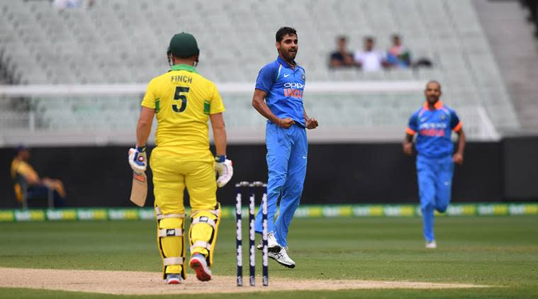 India's Bhuvneshwar Kumar, center, celebrates the wicket of Australia's Aaron Finch during their one day international cricket match in Melbourne, Australia
