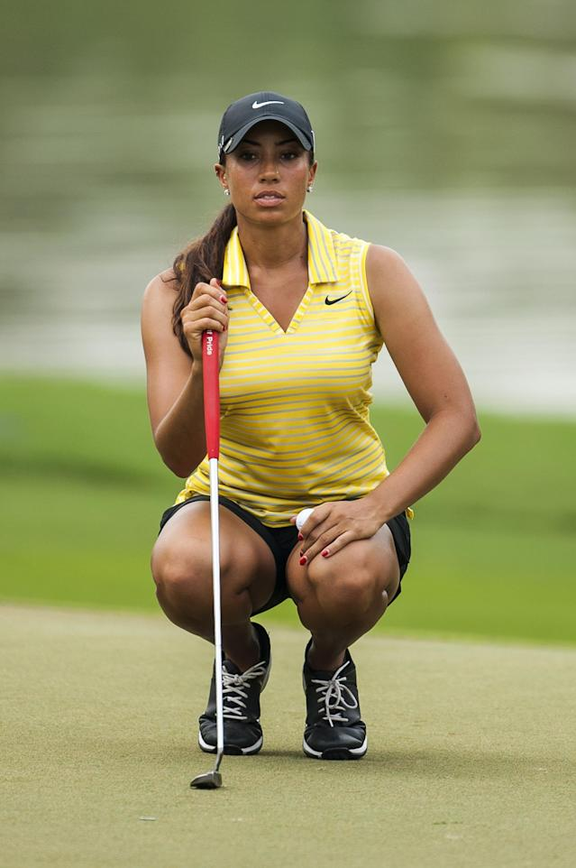 CHON BURI, THAILAND - FEBRUARY 21: Cheyenne Woods of USA lines up a putt on the 8th green during day one of the 2013 Honda LPGA Thailand at Siam Country Club on February 21, 2013 in Chon Buri, Thailand. (Photo by Victor Fraile/Getty Images)