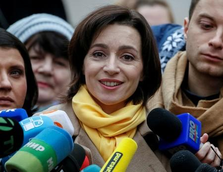 FILE PHOTO: Moldova's Action and Solidarity Party presidential candidate Sandu speaks to media after voting in presidential election in Chisinau
