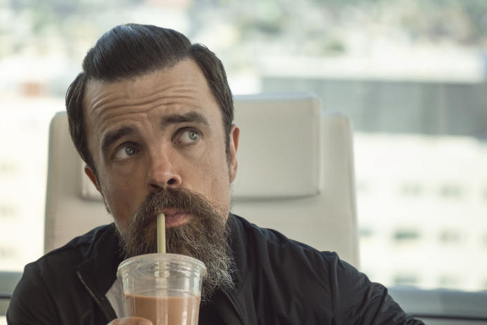 """This image released by Netflix shows Peter Dinklage in a scene from """"I Care A Lot."""" (Seacia Pavao/Netflix via AP)"""
