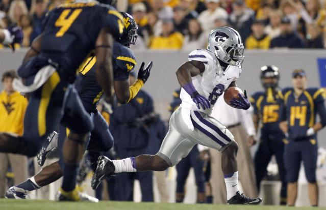 MORGANTOWN, WV - OCTOBER 20: Angelo Pease #8 of the Kansas State Wildcats carries the ball against the West Virginia Mountaineers during the game on October 20, 2012 at Mountaineer Field in Morgantown, West Virginia. (Photo by Justin K. Aller/Getty Images)