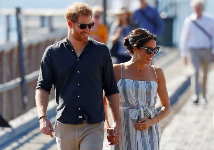 FILE PHOTO: Britain's Prince Harry and Meghan, Duchess of Sussex, arrive to greet members of the public in Kingfisher Bay on Fraser Island in Queensland
