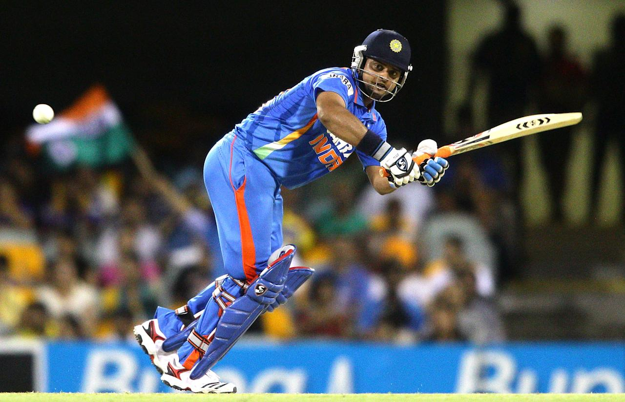 BRISBANE, AUSTRALIA - FEBRUARY 21:  Suresh Raina of India bats during game eight of the One Day International Series between India and Sri Lanka at The Gabba on February 21, 2012 in Brisbane, Australia.  (Photo by Bradley Kanaris/Getty Images)