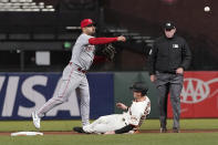 Cincinnati Reds shortstop Eugenio Suarez throws to first base after forcing out San Francisco Giants' Mike Yastrzemski at second base on a double play hit into by Alex Dickerson during the fifth inning of a baseball game in San Francisco, Tuesday, April 13, 2021. (AP Photo/Jeff Chiu)