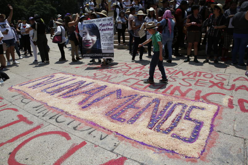 """A drawing reads in Spanish: """"Not one less"""" at the start of a silent march to remember murdered women and demand justice for them in Mexico City, Sunday, Sept. 8, 2019. Hundreds of women have taken to the streets of Mexico City to demand justice for loved ones, girls and countless women who have been sexually assaulted, murdered or gone missing in one of the most dangerous countries in the world to be a female. (AP Photo/Ginnette Riquelme)"""