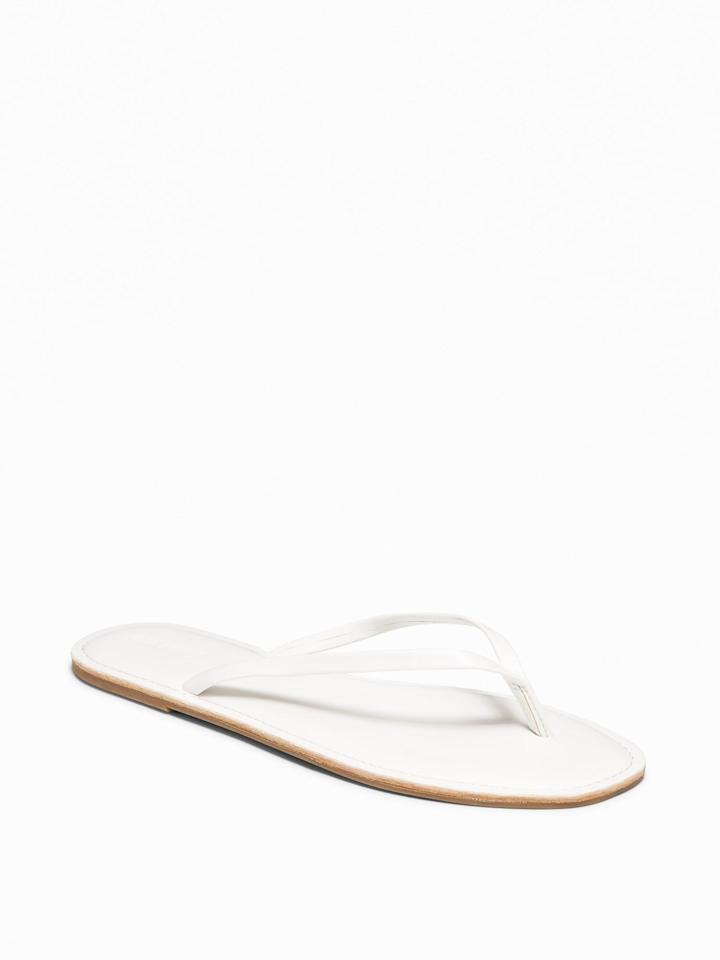 """<p>Flip-flops are back, and they're <a href=""""https://www.popsugar.com/fashion/Kim-Kardashian-Yeezy-Flip-Flop-Heels-June-2019-46256111"""" class=""""ga-track"""" data-ga-category=""""Related"""" data-ga-label=""""https://www.popsugar.com/fashion/Kim-Kardashian-Yeezy-Flip-Flop-Heels-June-2019-46256111"""" data-ga-action=""""In-Line Links"""">taking over this season</a>. Channel the early 2000s with a simple yet classic pair of easy, slide-on <a href=""""https://www.popsugar.com/buy/Faux-Leather-Capri-Sandals-476169?p_name=Faux-Leather%20Capri%20Sandals&retailer=oldnavy.gap.com&pid=476169&price=7&evar1=fab%3Aus&evar9=46461305&evar98=https%3A%2F%2Fwww.popsugar.com%2Fphoto-gallery%2F46461305%2Fimage%2F46461320%2FFaux-Leather-Capri-Sandals&list1=shopping%2Cold%20navy%2Csummer%2Csummer%20fashion&prop13=api&pdata=1"""" rel=""""nofollow"""" data-shoppable-link=""""1"""" target=""""_blank"""" class=""""ga-track"""" data-ga-category=""""Related"""" data-ga-label=""""https://oldnavy.gap.com/browse/product.do?pid=409631052&amp;cid=1077406&amp;pcid=68066&amp;grid=pds_221_372_1#pdp-page-content"""" data-ga-action=""""In-Line Links"""">Faux-Leather Capri Sandals</a> ($7, originally $13).</p>"""