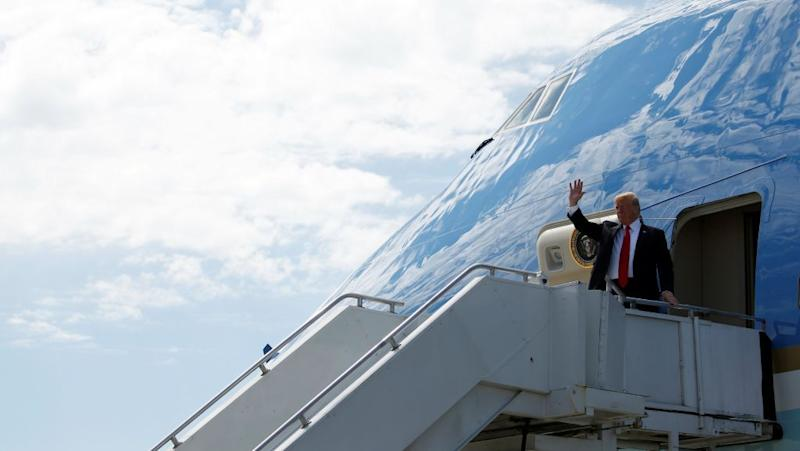 Donald Trump waves from Air Force One