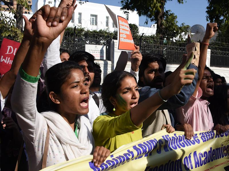 Indian students from Delhi University and Jawaharlal Nehru University shout slogans as they march behind a banner during a rally in New Delh: DOMINIQUE FAGET/AFP/Getty Images
