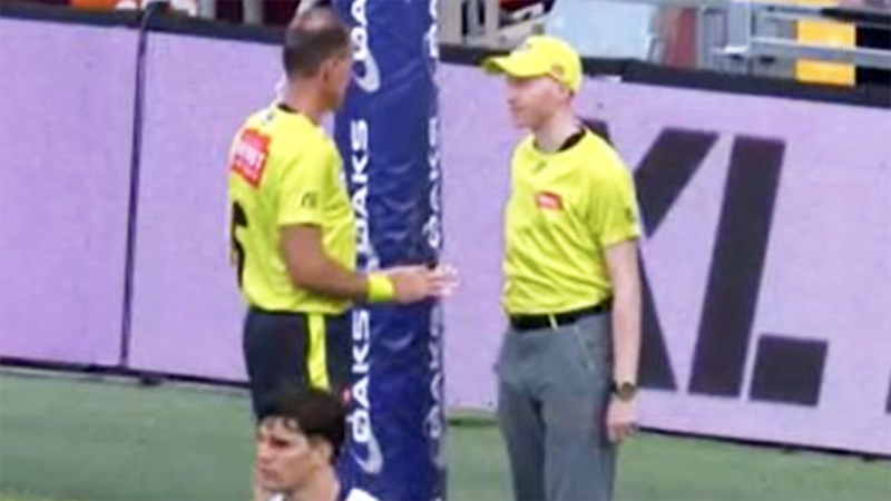 The umpires, pictured here conferring before calling a behind.
