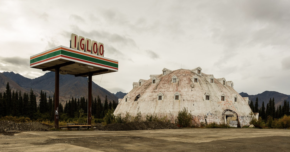 """<p>The abandoned Igloo Hotel near Cantwell, Alaska, never actually opened for business, as various code violations and structural problems plagued the hotel from ever welcoming a single guest. </p><p>The building has sat empty for over half a century, but some that travel to Alaska's no-man's land to see the unique hotel claim to <a href=""""https://www.onlyinyourstate.com/alaska/ak-urban-legends/"""" rel=""""nofollow noopener"""" target=""""_blank"""" data-ylk=""""slk:catch a glimpse"""" class=""""link rapid-noclick-resp"""">catch a glimpse</a> of the woman in white who supposedly haunts the desolate ruin.</p>"""