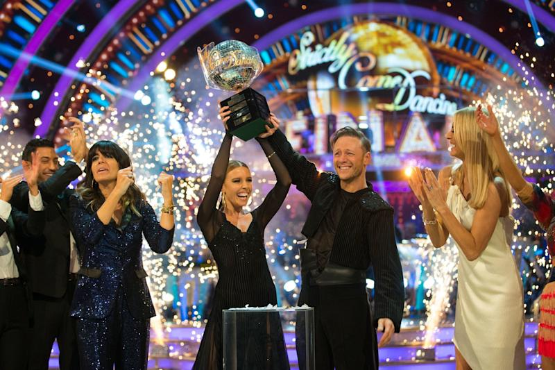Kevin Clifton and Stacey Dooley lift the glitterball trophy in the 2018 Strictly final (PA)
