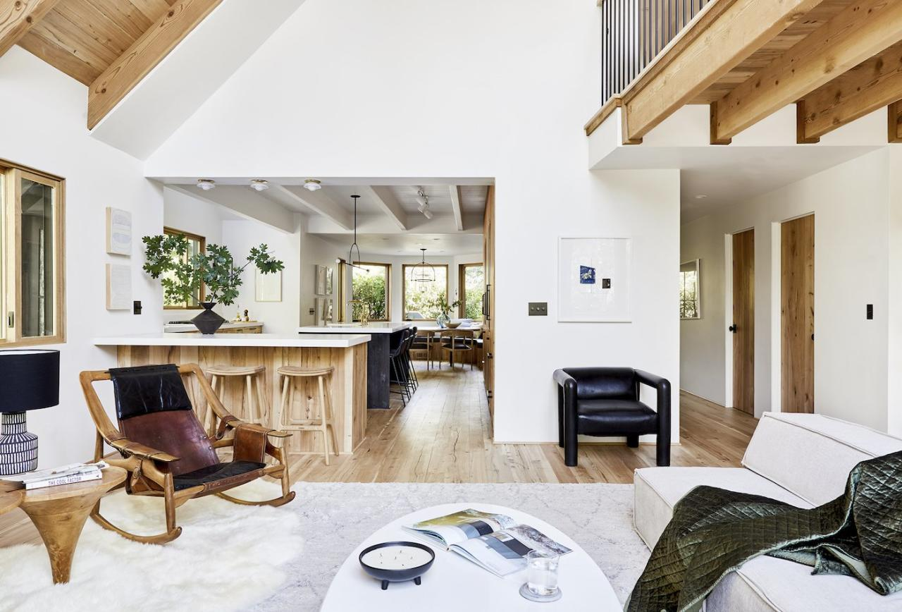 """<p>After the makeover, the design is bright and stylish, but also simple. """"We chose the most minimal version of <em>everything,""""</em> Henderson explains in <a href=""""https://stylebyemilyhenderson.com/blog/mountain-house-reveal-our-neutral-living-room"""" target=""""_blank"""">her blog post</a>. For example, she kept the original fireplace, but decided to plaster it with """"<a href=""""https://stylebyemilyhenderson.com/blog/stone-fireplace-makeover-mountain-house"""" target=""""_blank"""">German Schmear</a>"""" to reduce the contrast of the stones. You won't find much decorative molding or trim here, just a simple quarter round on the floor. </p> <p>The color palette is neutral, but a mix of materials—wood, stone, metal, leather—combine for a rich blend of textures. By prioritizing comfort and tranquility, Henderson created a space where everyone will want to get cozy. </p> <p><strong>RELATED: <a href=""""https://www.realsimple.com/home-organizing/decorating/best-white-paint-color"""" target=""""_blank"""">The 21 Best White Paint Colors, According to Top Designers</a></strong></p>"""