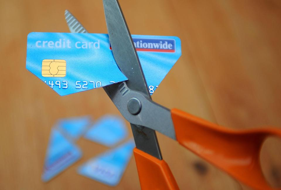 A credit card being cut up (PA Archive)