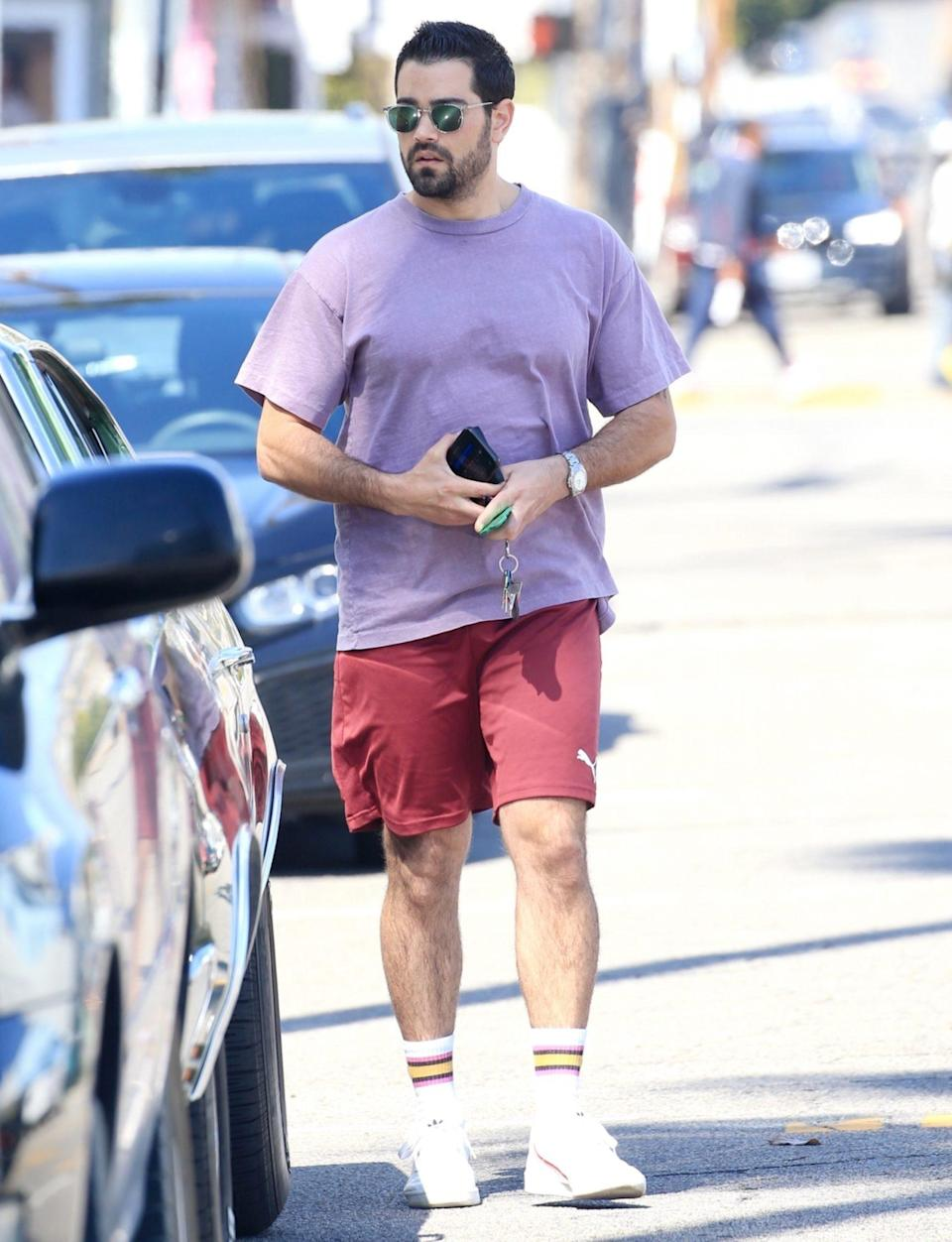<p>Jesse Metcalfe wears a lavender tee and red shorts on a sunny Wednesday out in West Hollywood.</p>