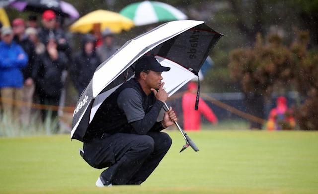 Tiger Woods slogged through a wet Friday at the British Open. (Getty)