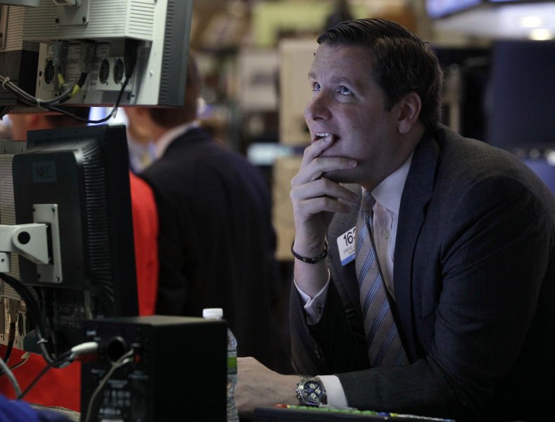 Specialist Gregg Maloney works on the floor of the New York Stock Exchange Monday, June 25, 2012. U.S. stocks are sliding at the opening of trading, following global markets lower after Spain requested help for its struggling banks. (AP Photo/Richard Drew)