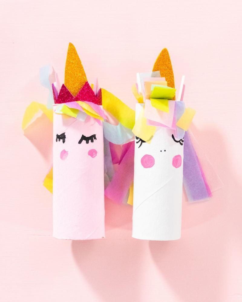 Making a unicorn out of the toilet paper roll and craft paper.