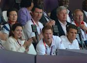 LONDON, ENGLAND - AUGUST 09: Princess Anne, Princess Royal (back L), her husband Sir Timothy Laurence, former athlete David Hemery (back R) Prince Harry (front C) and former rower James Cracknell (front R) watch the athletics on Day 13 of the London 2012 Olympic Games at Olympic Stadium on August 9, 2012 in London, England. (Photo by Jeff J Mitchell/Getty Images)
