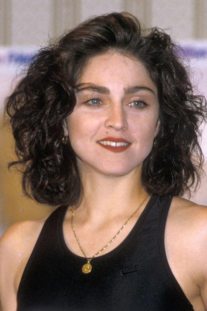 <p>A couple times throughout her iconic career, Madonna has shown us the true dark brown shade she was born with.</p>