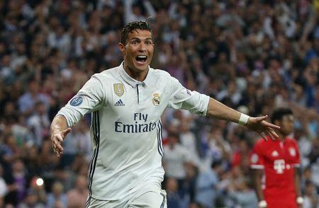 Real Madrid's Cristiano Ronaldo celebrates scoring their third goal to complete his hat trick