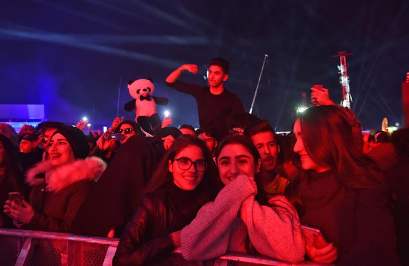 "Saudi fans attend the ""MDL Beast Fest"", an electronic music festival, held in Banban on the outskirts of the Saudi capital Riyadh on December 19, 2019. - Saudi Arabia's de facto ruler, Crown Prince Mohammed bin Salman, Prince Mohammed has sought to shake off his country's ultra-conservative image -- lifting a ban on cinemas and women drivers while allowing gender-mixed concerts and sporting extravaganzas. The relaxed social norms in a kingdom have been welcomed by many Saudis, two-thirds of whom are under 30. (Photo by Fayez Nureldine / AFP) (Photo by FAYEZ NURELDINE/AFP via Getty Images)"