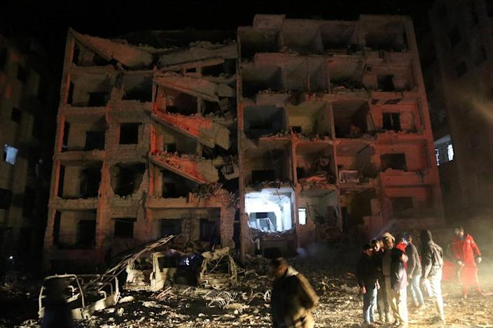 The blast at the base also badly damaged nearby buildings (AFP Photo/Zein Al RIFAI)