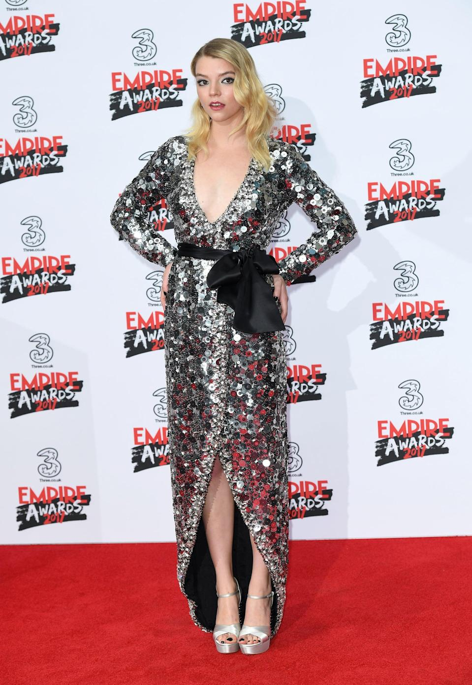 <p>Anya sparkled to the max in a silver Miu Miu gown and silver platforms.</p>
