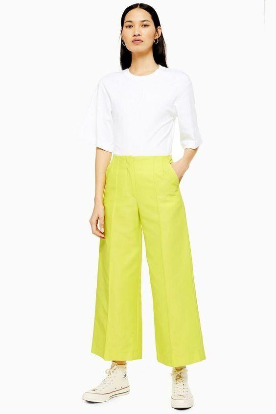 """<strong><a href=""""https://us.topshop.com/en/tsus/product/neon-awkward-cropped-trousers-by-boutique-8718950?Ntt=neon"""" target=""""_blank"""" rel=""""noopener noreferrer"""">Get the Neon cropped trousers by Boutique for $150.</a></strong>"""
