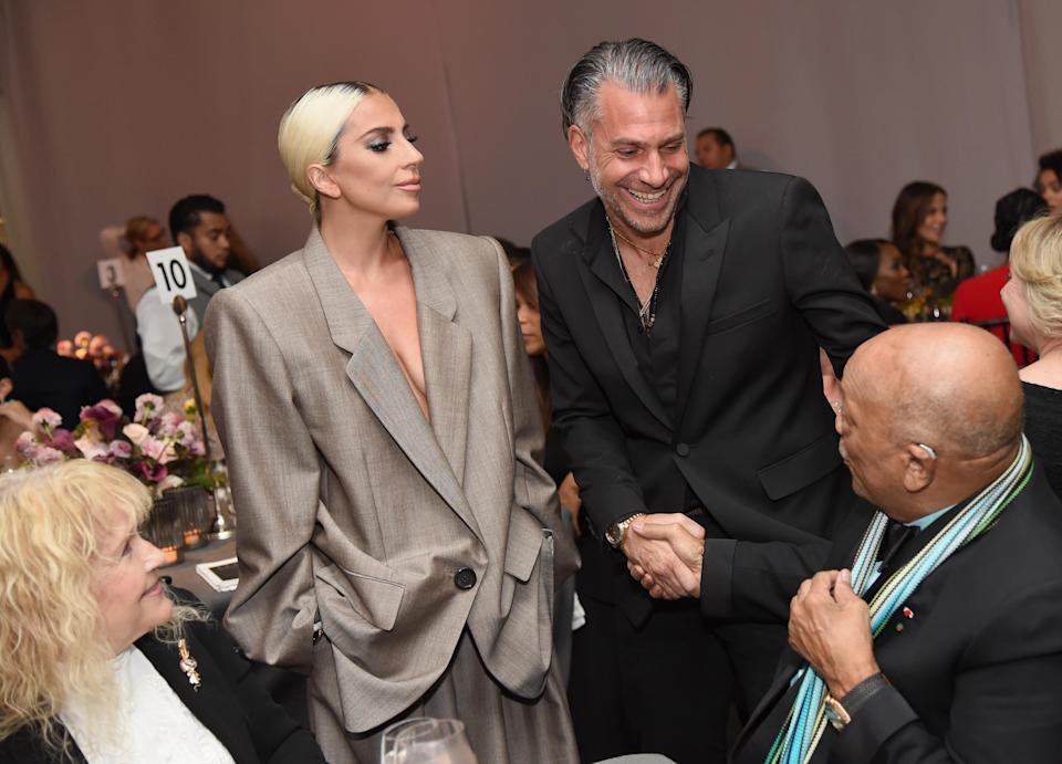 Lady Gaga and Christian Carino worked the room together, chatting with Mia Farrow and Quincy Jones, at <em>Elle</em>'s Women in Hollywood celebration on Oct. 15. (Photo: Getty Images)