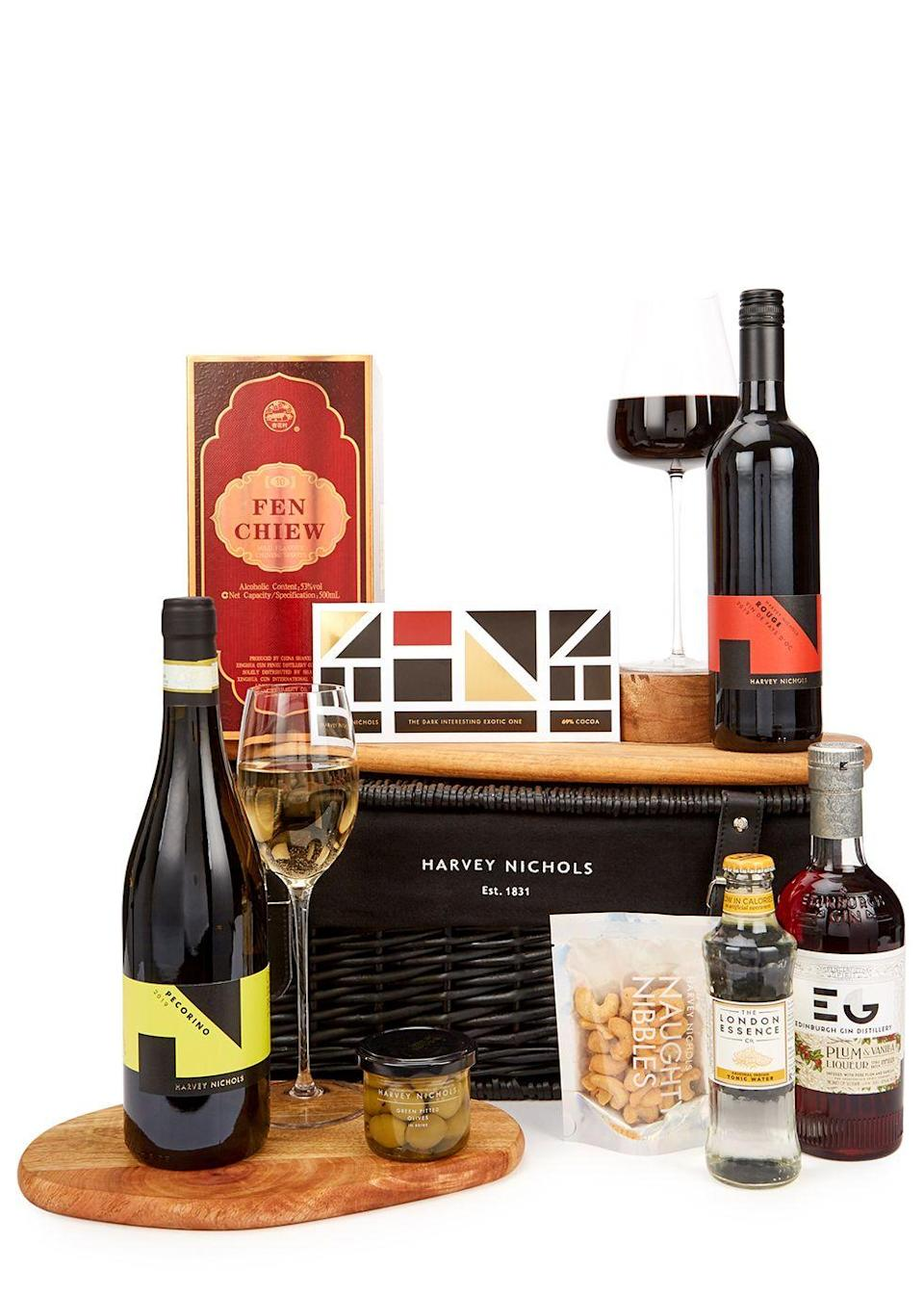 """<p>The past year has required us all to work exceedingly hard – much like the Ox does – and for a well-deserved treat, Harvey Nichols has curated a hamper to welcome the Lunar New Year. Including a traditional 10-year-old Baijiu crafted at Xinghuacun Fenjiu, a distillery whose history dates back six millenia; zestly lime and chilli nuts and dark chocolate, the result is a bundle of cheer with which to greet the year ahead. </p><p>Lunar New Year hamper, £140, Harvey Nichols.</p><p><a class=""""link rapid-noclick-resp"""" href=""""https://go.redirectingat.com?id=127X1599956&url=https%3A%2F%2Fwww.harveynichols.com%2Fbrand%2Fharvey-nichols%2F3330699-lunar-new-year-hamper%2Fp3970234%2F&sref=https%3A%2F%2Fwww.townandcountrymag.com%2Fuk%2Flifestyle%2Fg35176055%2F13-ways-to-celebrate-lunar-new-year%2F"""" rel=""""nofollow noopener"""" target=""""_blank"""" data-ylk=""""slk:SHOP NOW"""">SHOP NOW</a></p>"""