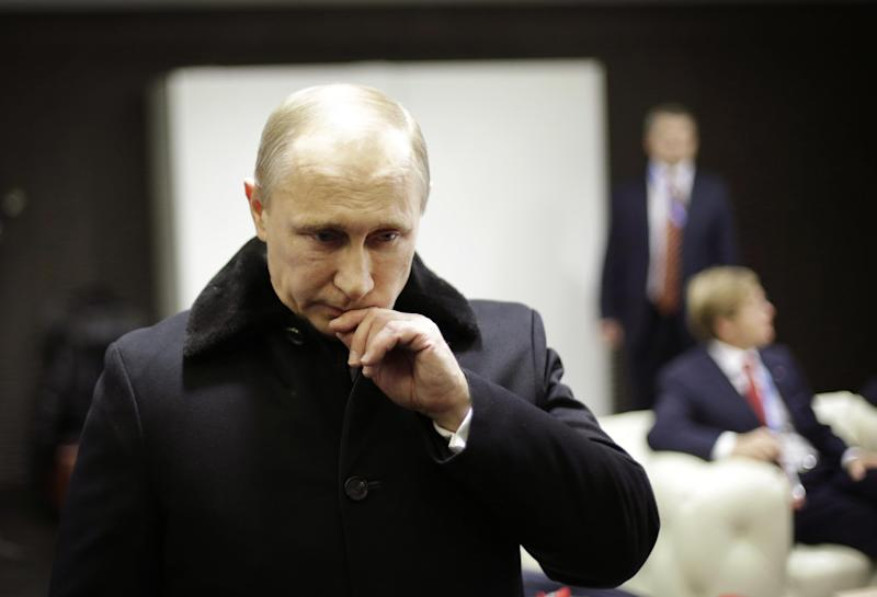 Russian President Vladimir Putin waits in the presidential lounge to be introduced at the opening ceremony of the 2014 Winter Olympics, Friday, Feb. 7, 2014, in Sochi, Russia. (AP Photo/David Goldman, Pool)