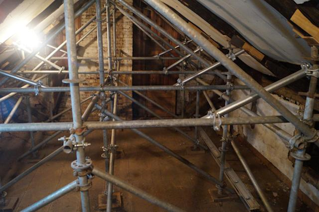 Interior scaffolding is currently supporting the structural integrity of the Frazee House. (Photo: Michael Walsh/Yahoo News)