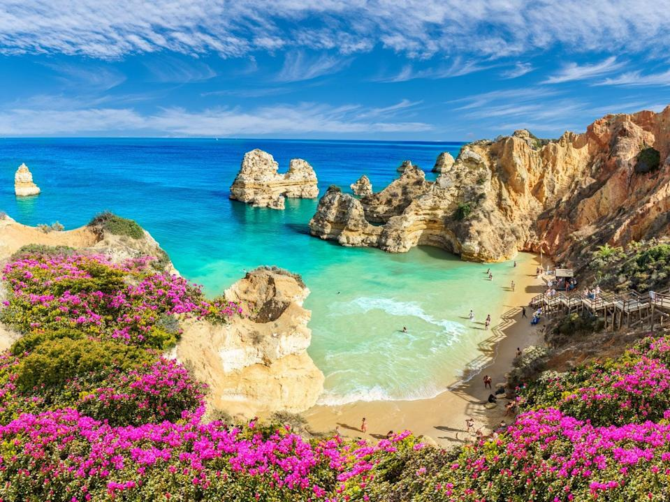 Praia do Camilo beach in Portugal, one of the 'green list' destinations (Getty Images/iStockphoto)