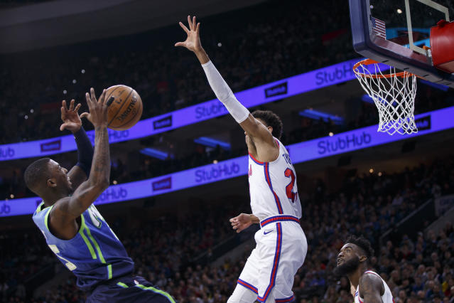 Dallas Mavericks' Delon Wright, left, misfires a shot as Philadelphia 76ers' Matisse Thybulle, right, defends during the first half of an NBA basketball game, Friday, Dec. 20, 2019, in Philadelphia. (AP Photo/Chris Szagola)