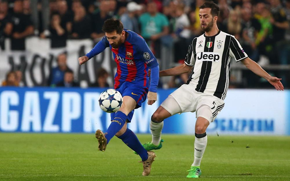 Barcelona Lionel Messi in action with Juventus Miralem Pjanic - Credit: REUTERS