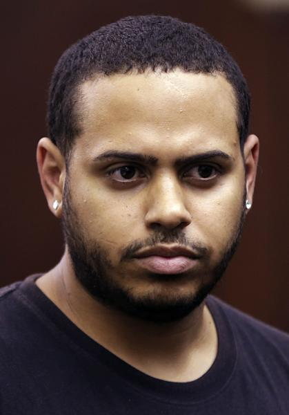 Christopher Cruz appears in criminal court in New York, Wednesday, Oct. 2, 2013. Cruz was charged Wednesday with reckless driving after prosecutors said he touched off a tense encounter with the driver of an SUV and a throng of other bikers. (AP Photo/Seth Wenig)