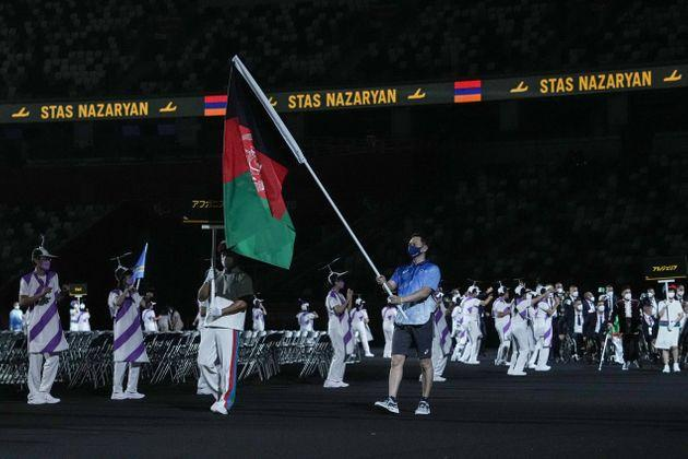 The flag of Afghanistan is carried out at the opening ceremony for the Tokyo 2020 Paralympic Games. (Photo: YASUYOSHI CHIBA via Getty Images)