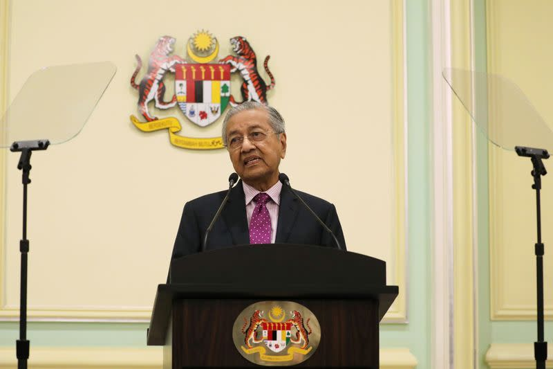 Malaysia unveils $4.7 billion stimulus, cuts growth forecast due to virus outbreak