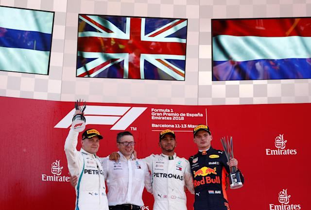Formula One F1 - Spanish Grand Prix - Circuit de Barcelona-Catalunya, Barcelona, Spain - May 13, 2018 Mercedes' Lewis Hamilton celebrates on the podium after winning the race with second placed Mercedes' Valtteri Bottas (L) and third placed Red Bull's Max Verstappen (R) REUTERS/Juan Medina