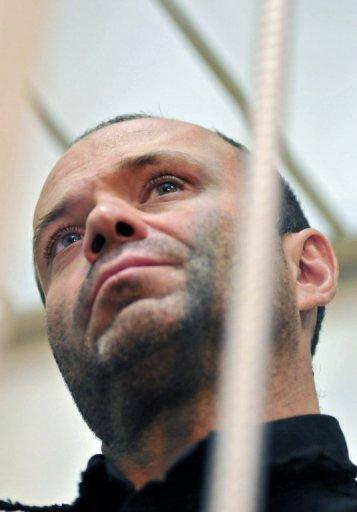 <p>Dmitry Pavlyuchenkov in a court room in Moscow on August 26, 2011. The former police officer has been charged with murder for being part of a criminal group that gunned down Politkovskaya in 2006. Investigators believe the gang was formed on the orders of Chechen criminal boss Lom-Ali Gaitukayev.</p>