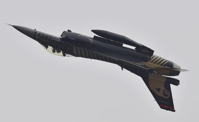A Turkish fighter jet performs an aerobatic stunt during a military parade to mark Pakistan National Day, in Islamabad, Pakistan, Saturday, March 23, 2019. Pakistanis are celebrating their National Day with a military parade that's showcasing short- and long-range missiles, tanks, jets, drones and other hardware. (AP Photo/Anjum Naveed)