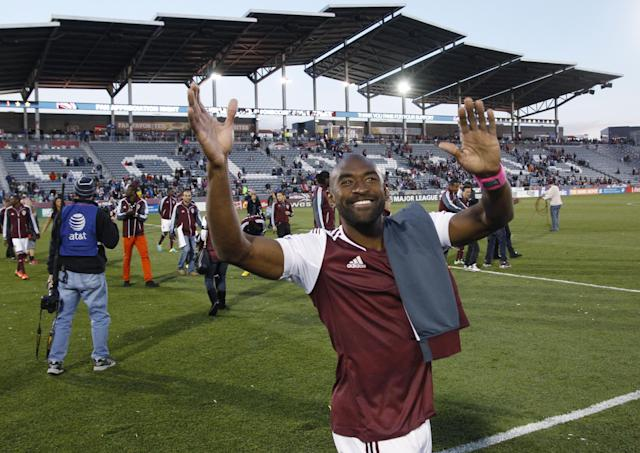 Colorado Rapids defenseman Marvell Wynne celebrates after the Rapids' 3-2 victory over the Vancouver Whitecaps in an MLS soccer game in Commerce City, Colo., on Saturday, Oct. 19, 2013. (AP Photo/David Zalubowski)