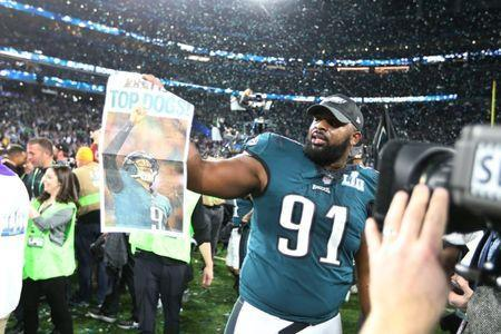 Feb 4, 2018; Minneapolis, MN, USA; Philadelphia Eagles defensive tackle Fletcher Cox (91) celebrates after defeating the New England Patriots to win Super Bowl LII at U.S. Bank Stadium. Mandatory Credit: Kirt Dozier-USA TODAY Sports