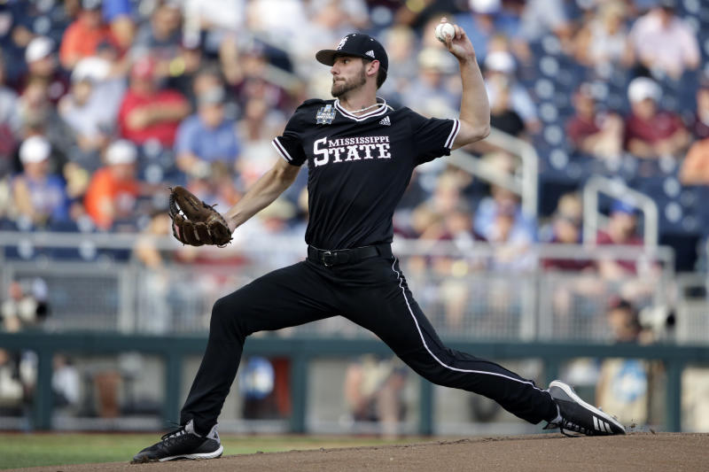 Mississippi State pitcher Ethan Small delivers against Auburn in the first inning of an NCAA College World Series baseball game in Omaha, Neb., Sunday, June 16, 2019. (AP Photo/Nati Harnik)