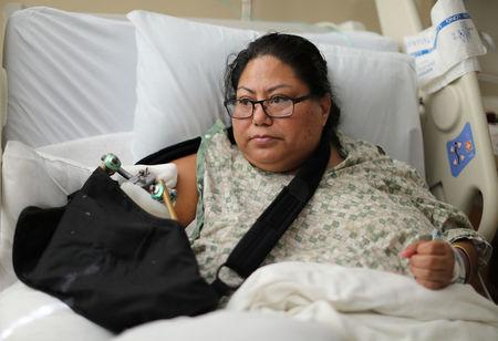 Paola Bautista, 39, from Fontana, California, sits in her hospital bed at Sunrise Hospital & Medical Center after being shot at the Route 91 music festival mass shooting next to the Mandalay Bay Resort and Casino in Las Vegas, Nevada, U.S. October 4, 2017. Picture taken October 4, 2017. REUTERS/Lucy Nicholson