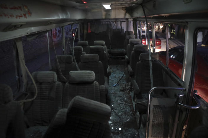 Shattered glass litters the inside of a mini-bus after a bomb attack in Kabul, Afghanistan, Monday, Dec. 28, 2020. (AP Photo/Rahmat Gul)