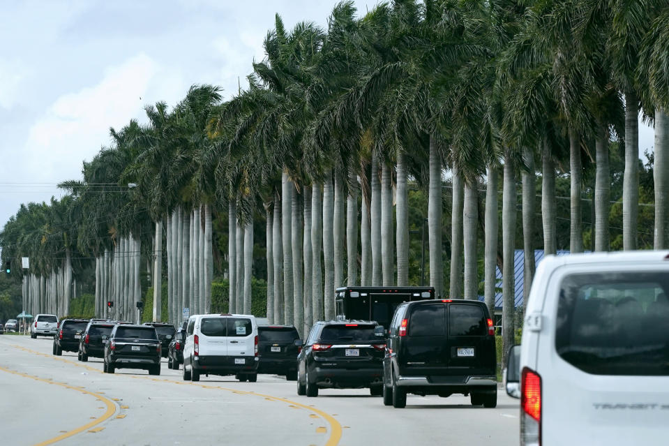 President Donald Trump's motorcade drives to Trump International Golf Club, Thursday, Dec. 24, 2020, in West Palm Beach, Fla. (AP Photo/Patrick Semansky)