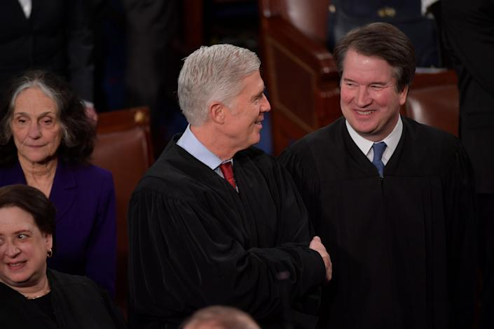 Associate Justices Neil M. Gorsuch and Brett M. Kavanaugh in the House chamber for the State of the Union address in Washington on Feb. 4, 2020.