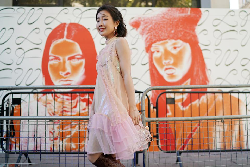 A guest is seen wearing a tulle pink dress outside the BFC showspace. [Photo: Getty Images]